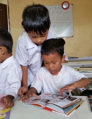 Engaged in books at the Myanmar Refugee School KL Malaysia